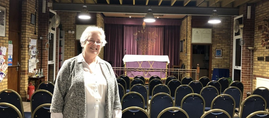 Irit Shillor standing proudly in the Harlow Jewish Community Synagogue